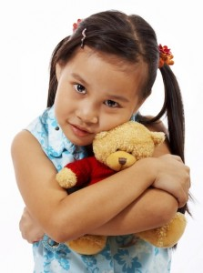 Teddy Bear Being Hugged And Cuddled By A Young Girl